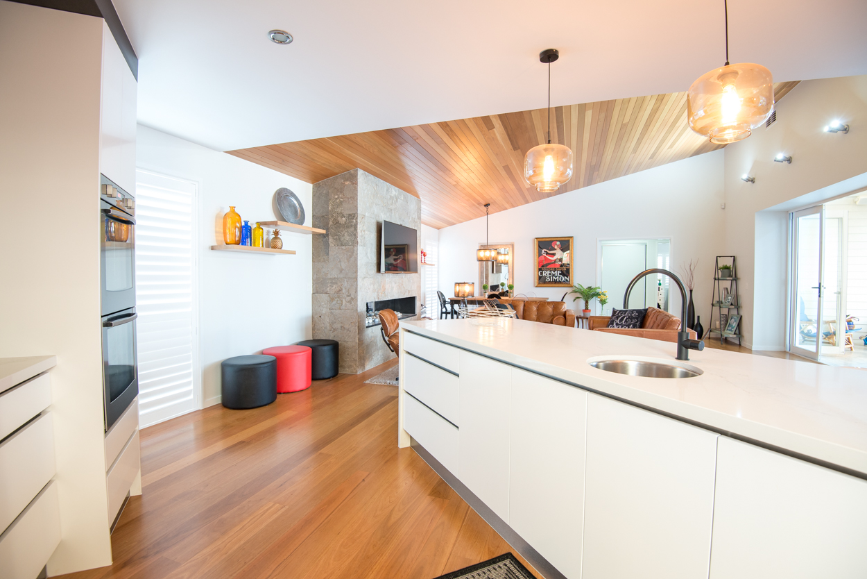 White kitchen and timber ceiling