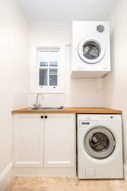 Laundry with white walls