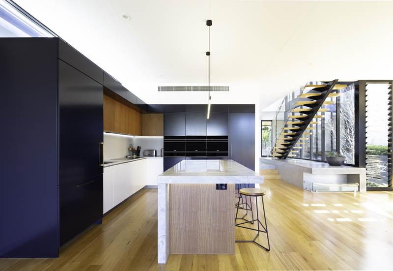 Kitchen with dark cupboards