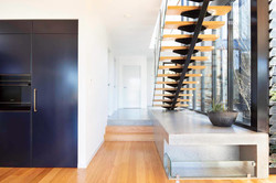 Stairs and navy cupboards