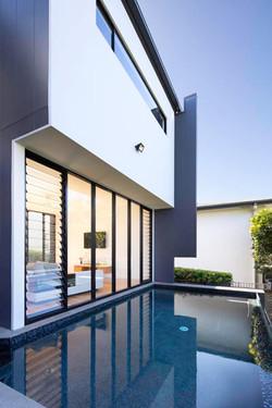 Pool next to house