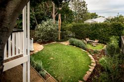 Grassy backyard of renovated home