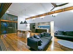 Open plan living with high ceiling