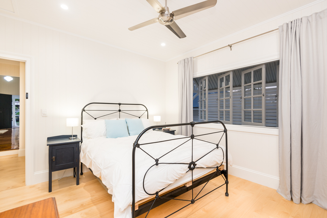 White bedroom in renovated home