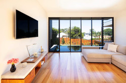 Living area with view of pool