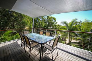 Outside deck dining with ocean views