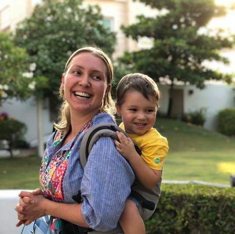 Anastasia back carrying her toddler