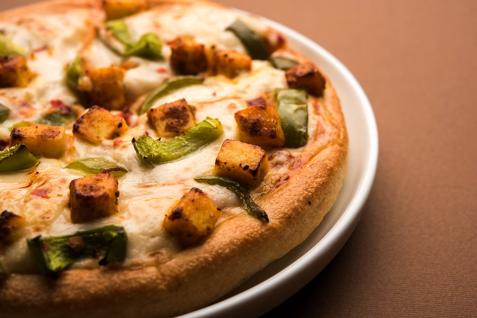 paneer-pizza-is-indian-version-italian-dish-topped-with-cottage-cheese-served-plate-with-w