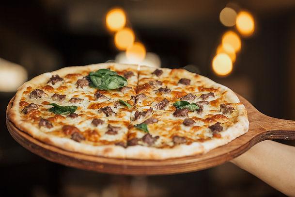 mixed-ingredient-pizza-wooden-board.jpg