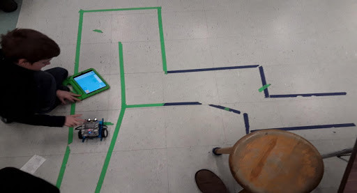 student working on a robotics activity