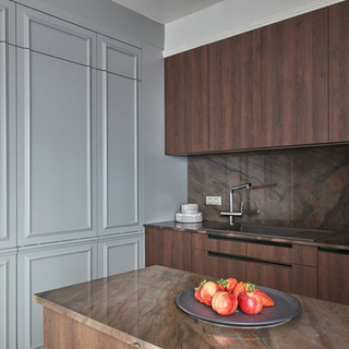 The wallcover is a cabinet for fridge and oven