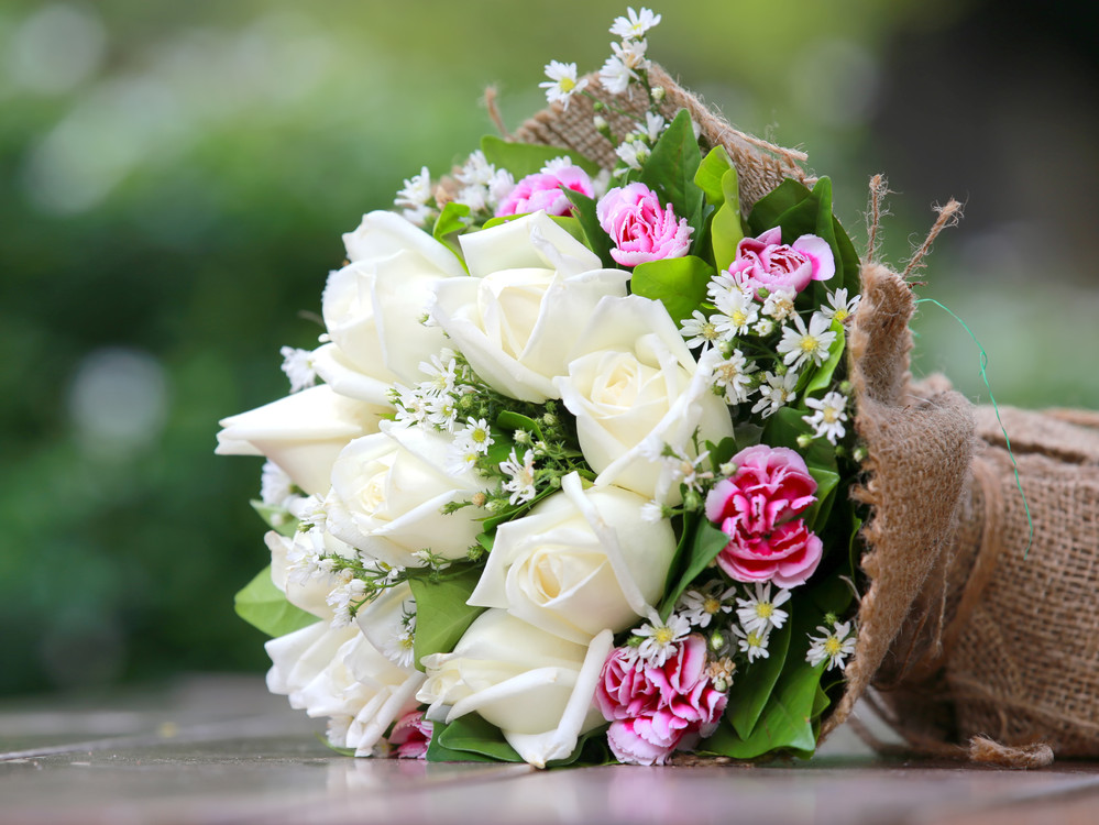 white roses in burlap.jpg