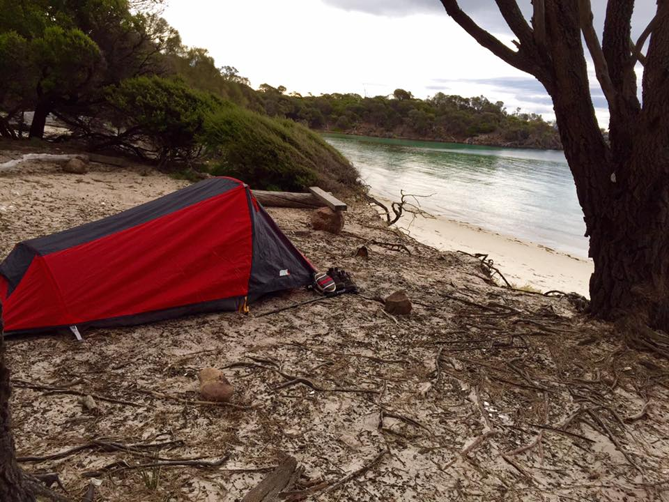 Set up camp for the night on Day 1 at Cooks Beach - Freycinet Circuit