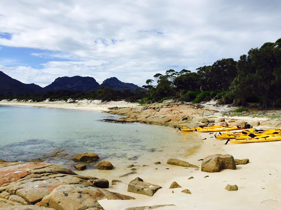 A small group of Kayakers have set up camp - Freycinet Circuit