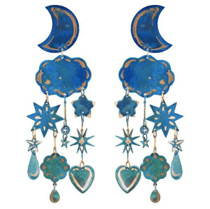 earrings made from brass shapes cut into moons and clouds painted with blue patina