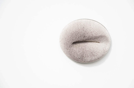 large oval shaped brooch made from light grey reindeer hair