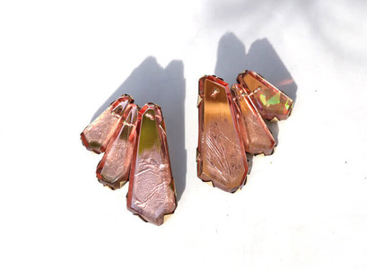 rose gold studs in the shape of a fan made from plexiglass and metal