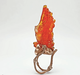 Ring from delight collection, bronze setting with large orange shaped resin flame