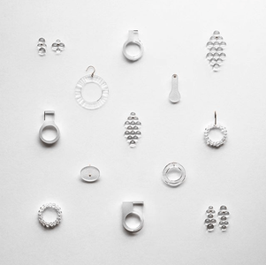 a collection of glass earrings by bubun on a white table