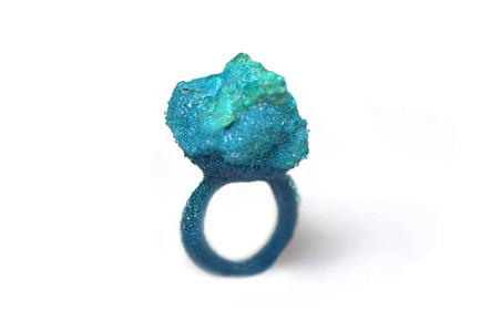 aquamarine ring that looks like bright coral made from enamel