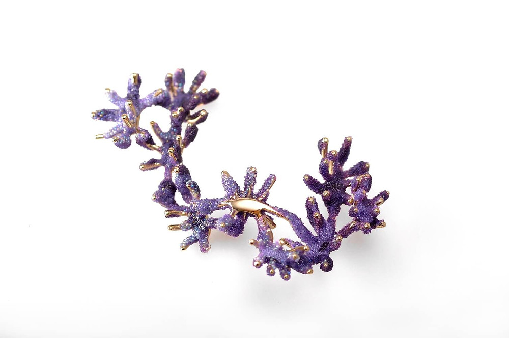 purple and gold coral brooch with enamel and small glass beads that give the texture of coral