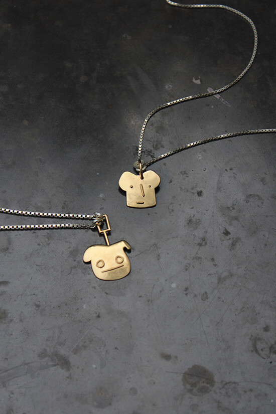 Necklace with shapes cut out into the shape of bread with faces on them