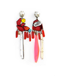 Long earrings made up of small shapes of red, yellow and clear plexiglass all attached to a large pearl at the top that attaches to the ear