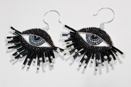 Pair of black eye earrings with grey irises, hand embroidered with beads