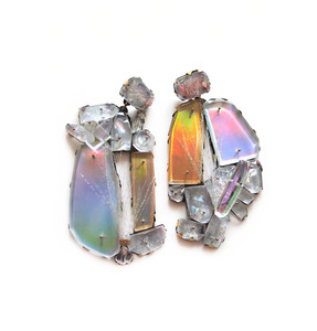 earrings made from large clusters of different size plexiglass shapes with a silver palm frond attached to each earring