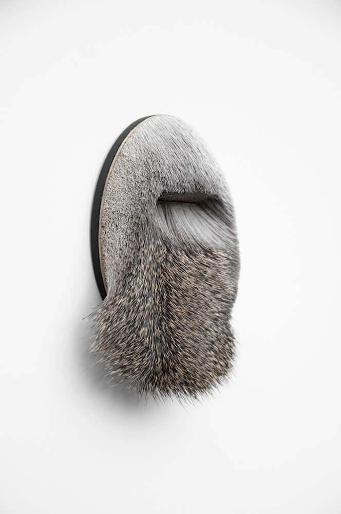 Brooch made from long grey reindeer hair
