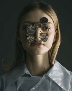 woman wearing mask made up of different size discs