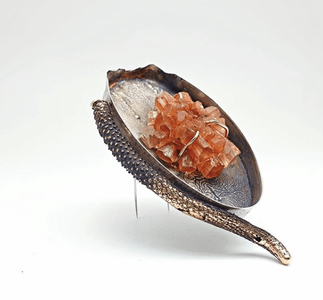 Wabi-sabi brooch made from sterling silver and 14 carat yellow gold with an argonite crystal set in the middle