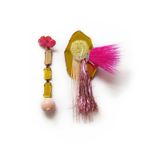pink and yellow earrings made from plexiglass with a piece of bright pink hair from a toy troll attached to one earring