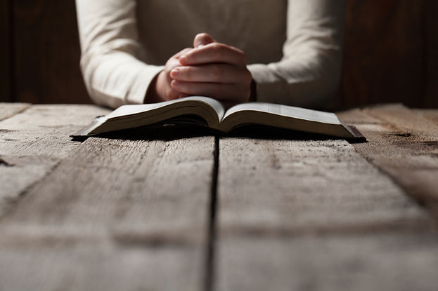 bible-hands-praying-over.jpg