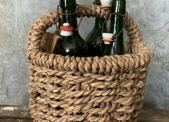 Vintage bottles in basket