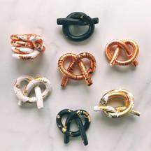 Metallic Knots