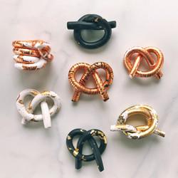 Metallic clay knots