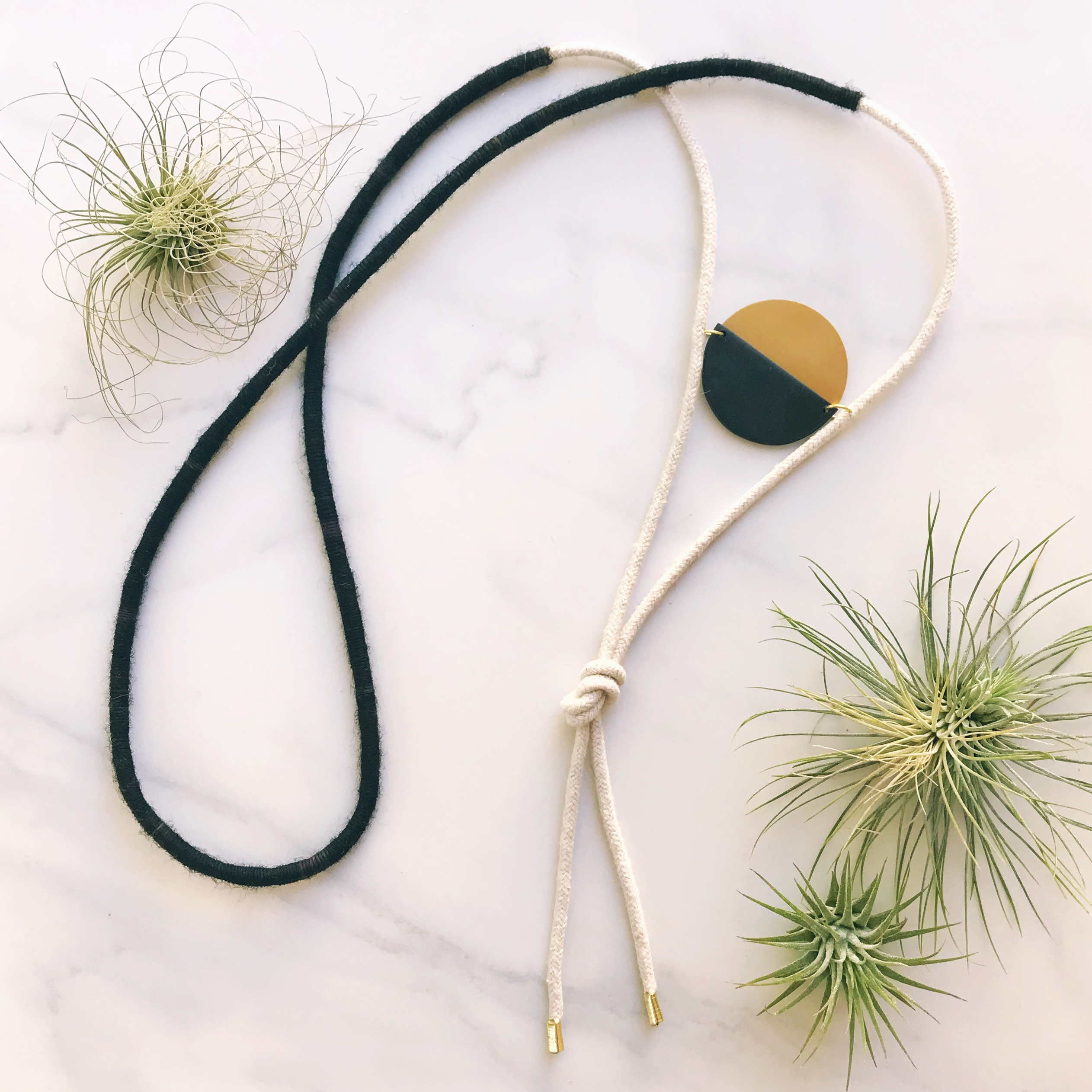 eclipse clay brass wool necklace