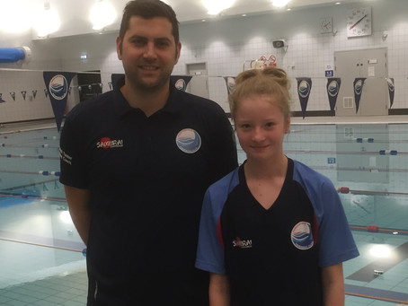 Swimmer and Coach on England Programmes Camp