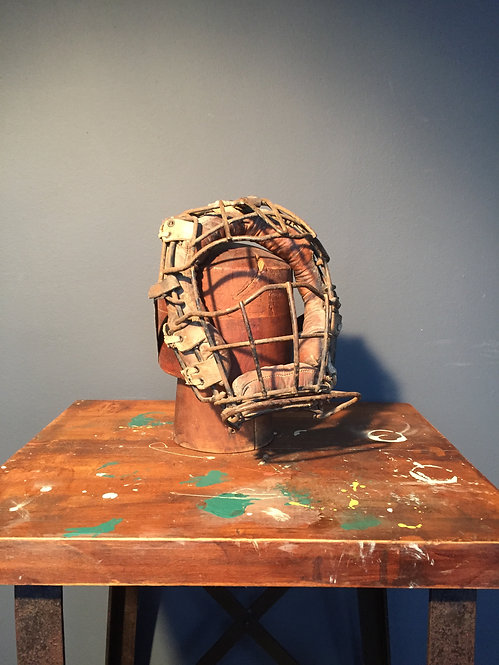 Leather and steel baseball mask with hat stand
