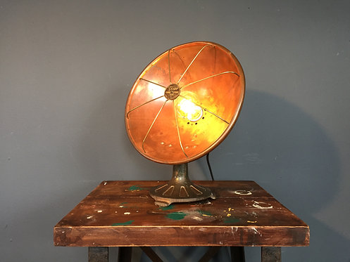 Early century brass and copper heating lamp conversion to a table lamp
