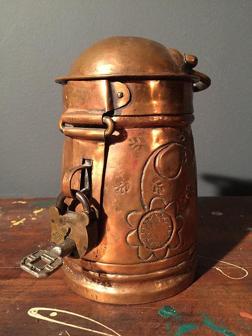 Antique brass contribution box with padlock