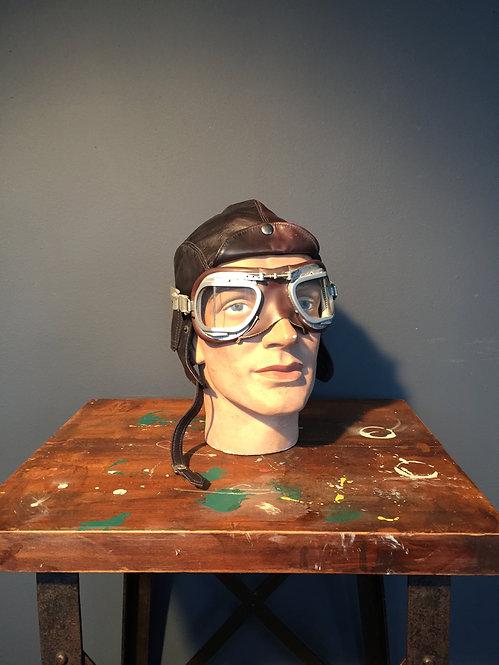 Automobilia display with stadium Mark 9 Super Jet leather goggles