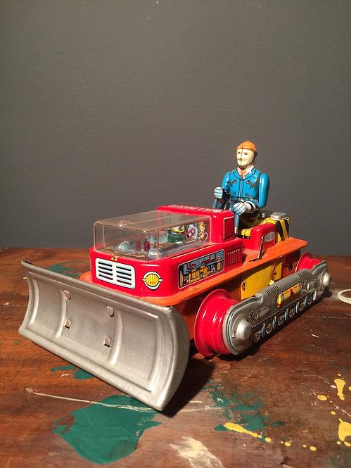 1960s Nomura Japanese battery operated magic bulldozer