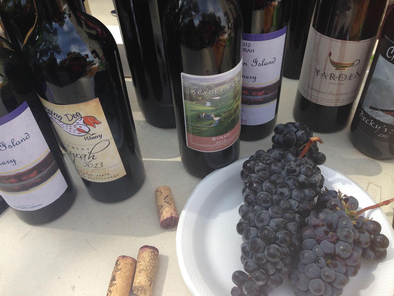 Members bring their previous years wines