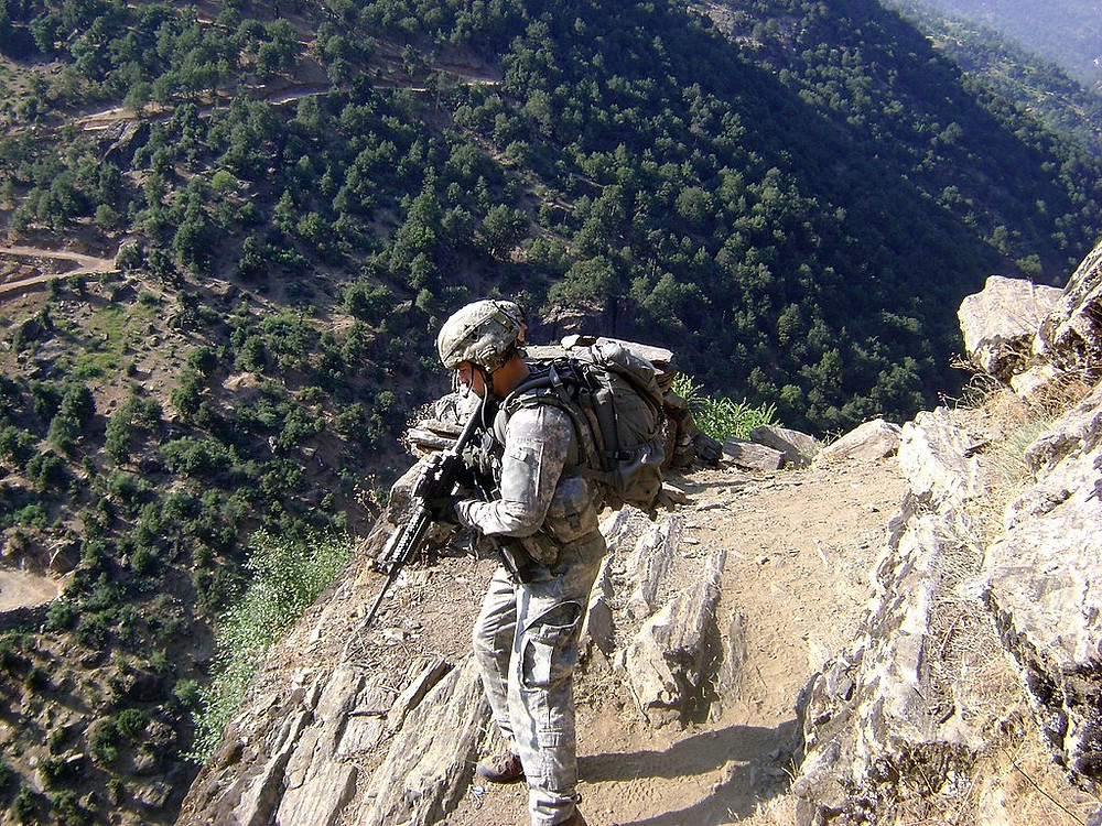 U.S. Army Staff Sgt. Clinton L. Romesha patrols near Combat Outpost Keating in Kamdesh, Nuristan province, Afghanistan, July_27,_2009. He was awarded the Medal of Honor for his actions on the day of the battle..