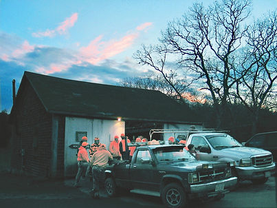 Deer hunters gather at the state forest check station on Martha's Vineyard.