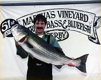 Nelson Sigelman holds a 31.29 pound striped bass caught on a fly rod in the 1996 Bass and Bluefish Derby.