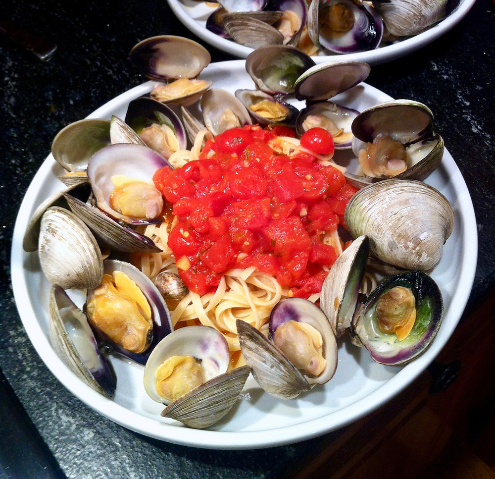 The key to this dish is to remove the clams the moment they open.