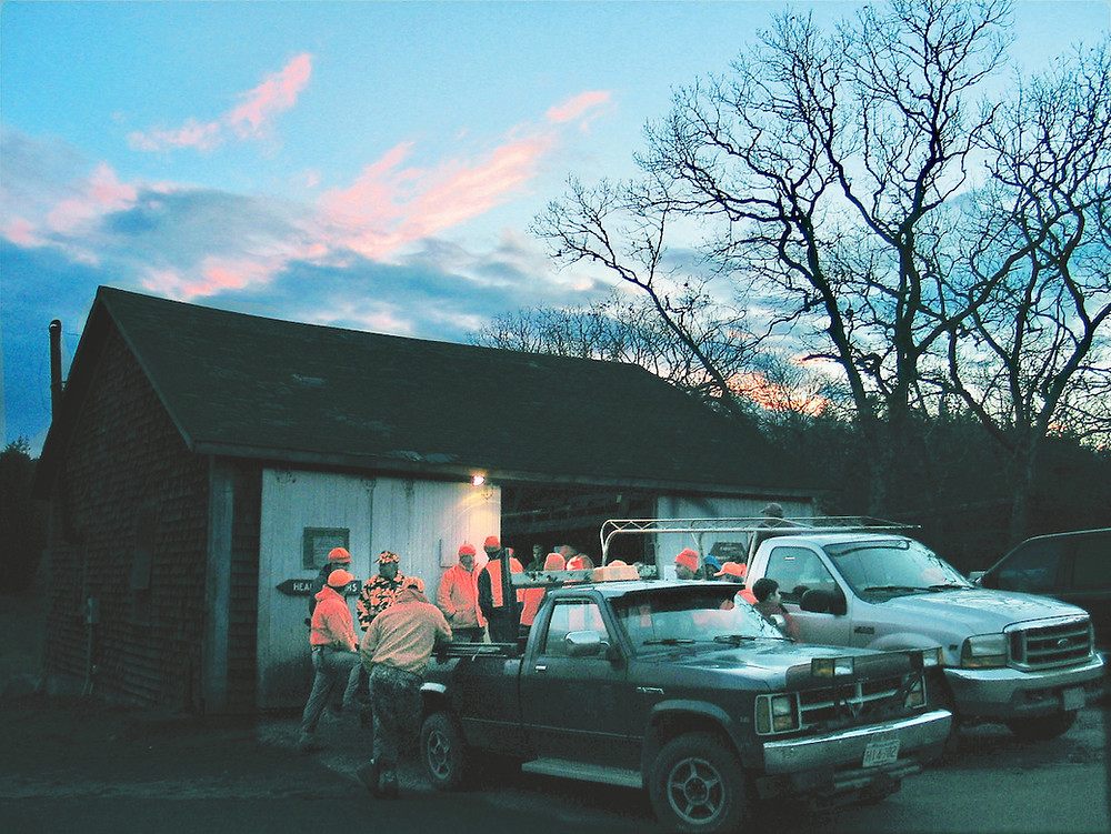 On Martha's Vineyard, Island deer hunters gather at the state forest deer check station on the opening day of the 2003 shotgun season. The shed is no longer used. Photo by Ezra Newick